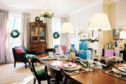 A wooden dining table decorated for the holidays