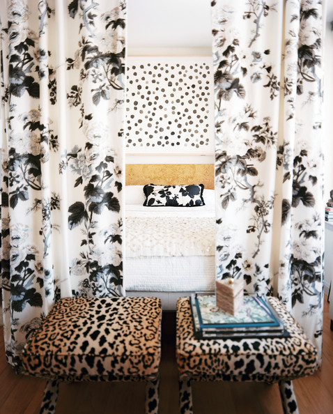 Canopy Curtains - A floral bed canopy and a pair of leopard-print benches