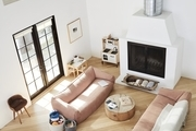 A minimalist living room in a Los Angeles home with neutral tones and blush accents.