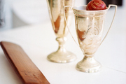 Silver trophies on a white tabletop