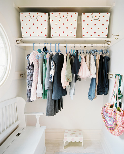 Closet - A polka-dotted stool and a white bench in a girl's closet