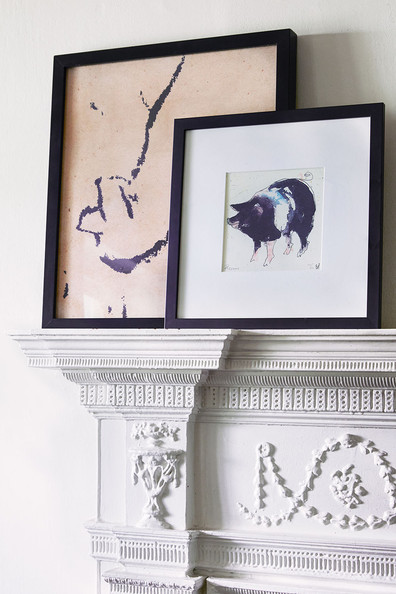 Colonial Fireplace - Framed art on a fireplace mantel