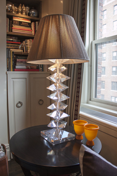 Contemporary Bookshelf - A crystal desk lamp in the corner of a living room