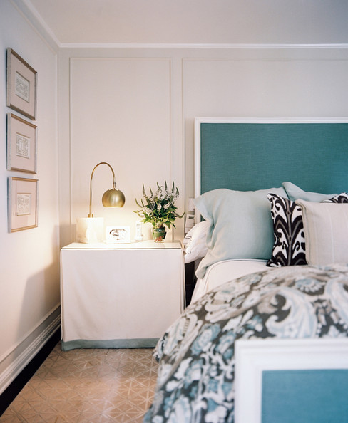 Creative Headboard - A skirted bedside table paired with a blue upholstered bed