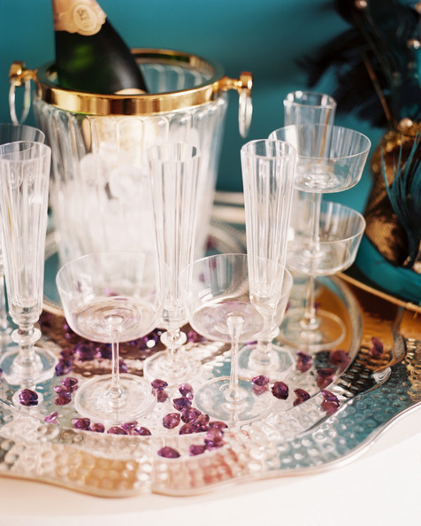 December 2012 Issue - A serving tray of clear glassware and champagne on ice