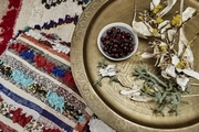 A serving tray laying on top of a patterned rug.