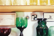 Colorful barware surrounded by framed artworks