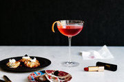 A Campari-Lillet cocktail paired with oysters and cauliflower fritters