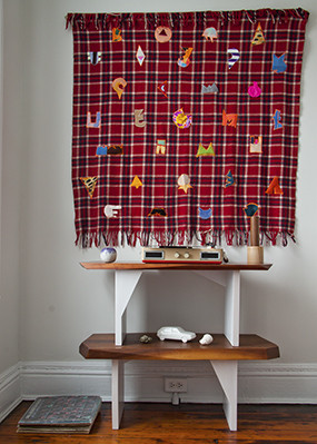 Electronics - Eclectic patches turn this plaid blanket into a work of art.