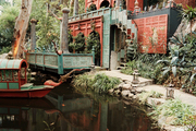 A koi-filled pond surrounded by opulent Eastern-inspired architecture