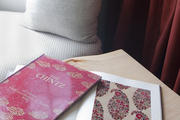 An archive of chintz textiles near a window seat