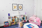 Kids room with playful seating and a bunch of colorful books.