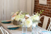 A neutral tablescape with white flowers.