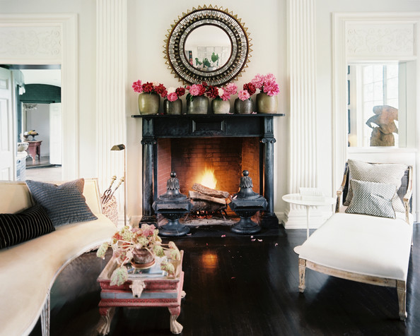 Fireplace - Vases of pink peonies atop a black marble mantel