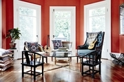 A living space with deep orange walls.