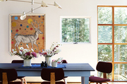 Vintage Thonet chairs, recovered in Knoll fabric, surround a Shaker-style dining table built by Patrick Moore