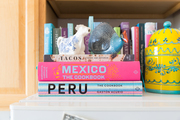 A detail of colorful books on a shelf.