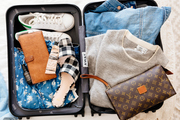 An overhead of a packed suitcase.