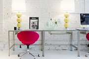A contemporary work space with a rolling chair