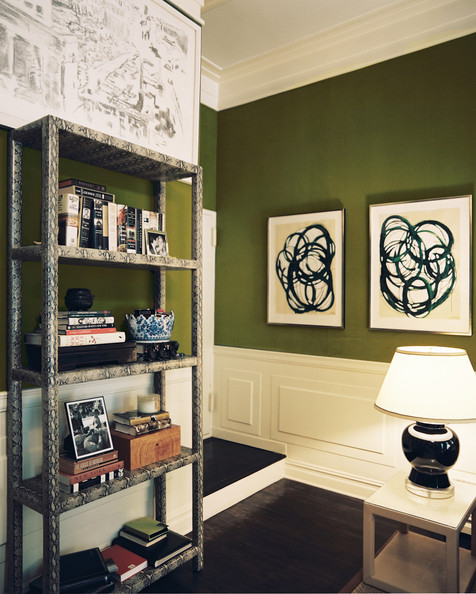 Hallway Green - A snakeskin-print bookcase and a white end table with a black lamp