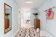 A colorful entryway with blue walls.