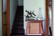 Various types of wood fill a hallway