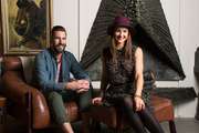 Scott Jarrell and Kristan Cunningham by the fireplace at their LA store, Hammer and Spear