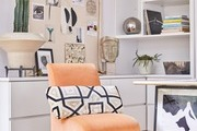 Vintage peach-colored accent chair in home office.