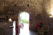 A romantic hotel bar with barrel-vaulted stone ceilings