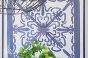 A detail of a framed blue and white textile.