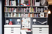 A collection of books on white shelves