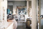 A shop filled with antique furnishings and architectural fragments