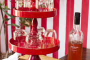Stemless wine glasses in a three-tiered tray