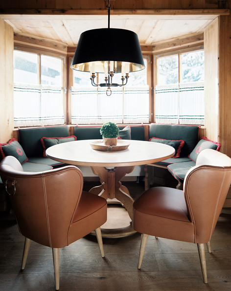 January February 2013 Issue - A dining space with leather chairs and a banquette set in a bay window