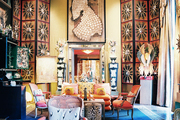 A grand living space accented with ceiling-height folding screens