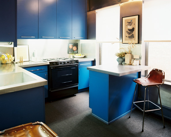 Kitchen  Blue cabinets and stainless steel countertops paired with a