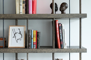 Open shelving and vintage books at the home of London designer Tara Bernerd