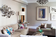 Neutral furniture and patterned pillows in a serene living space