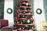 A Christmas tree surrounded by holiday decorations