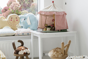 A kid's room with white walls and brown animal stools.