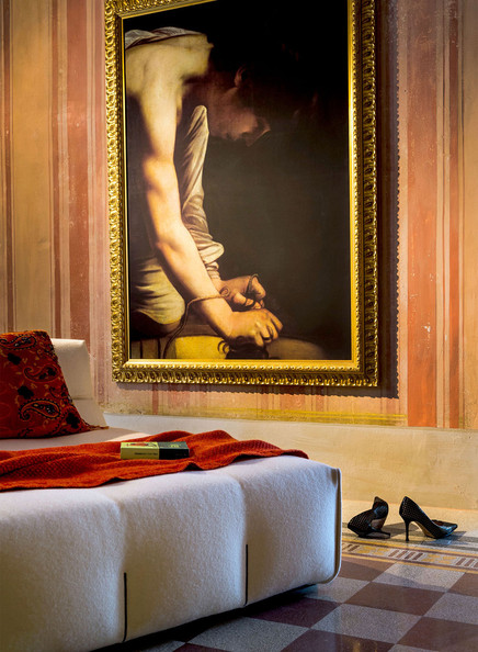 Library - A reproduction of a famous Caravaggio painting next to a contemporary daybed