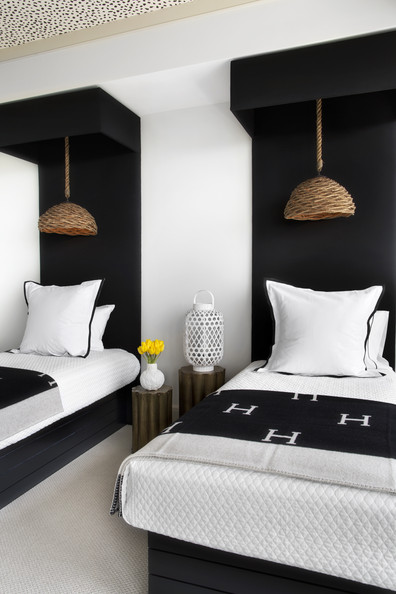 Lighting - Pendant lights with woven shades above a pair of twin beds