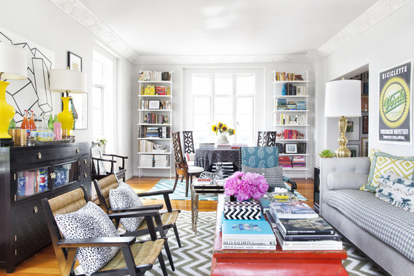 Living Room - Armchairs, a coffee table, and a couch atop a chevron-patterned area rug