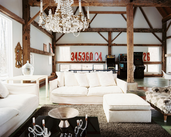 Living Room Brown - White couches and a crystal chandelier in a barn