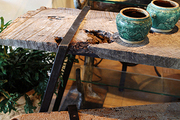 A rustic wooden console table and bench in a retail space