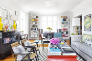 Armchairs, a coffee table, and a couch atop a chevron-patterned area rug