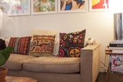 Framed art above a beige-colored couch