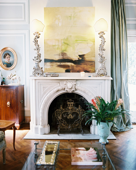 Mantel - A marble mantel surrounded by blue walls and curtains