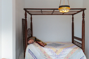 A traditional charpoy bed set in an alcove