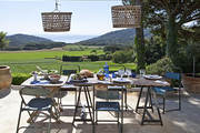 The dining terrace of a Costa Brava artist cottage and studio set for dinner.
